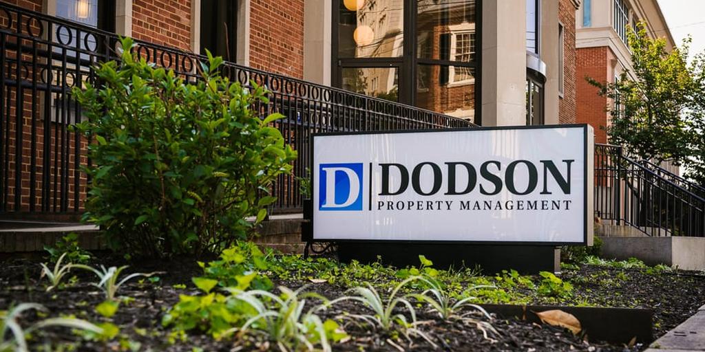 dodson property management sign